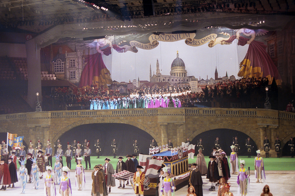 This is the end result. The backdrop was 40m wide. In the foreground is an ice rink, on which the boats and skaters performed the final scene. The flags on the boats were also painted by me. Queen Elizabeth II was present for this performance.
